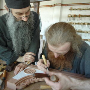 Father Avakum teaching Father Dimitrije wood carving 1