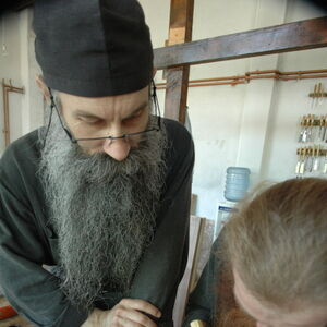 Father Avakum teaching Father Dimitrije wood carving 2