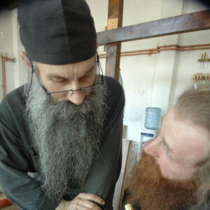 Father Avakum teaching Father Dimitrije wood carving 3