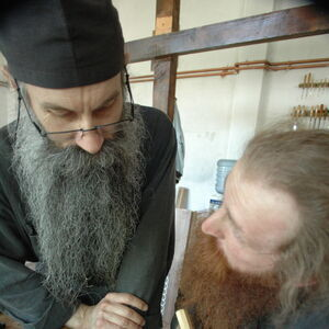 Father Avakum teaching Father Dimitrije wood carving 4
