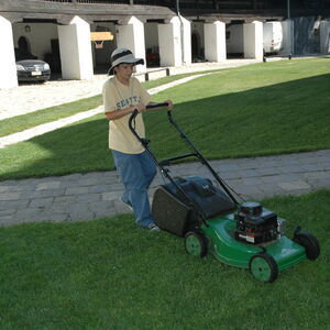 Stefan helps with mowing the grass in the churchyard