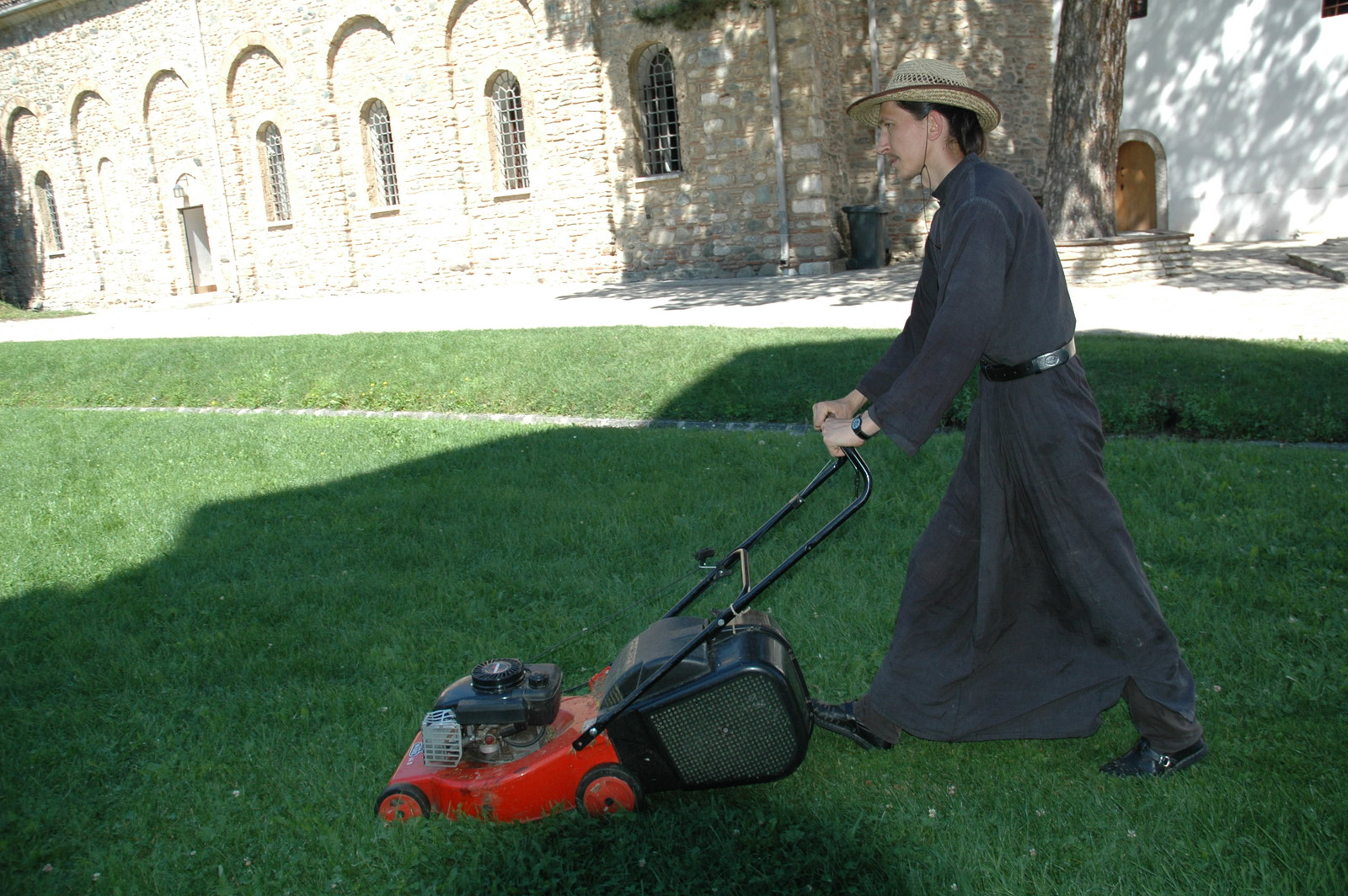 Mowing the grass in the churchyard